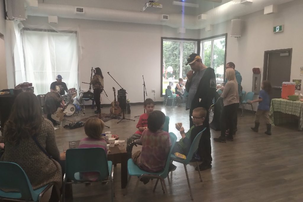 Grown-ups and children gather at the Strathearn Community League Hall to enjoy  live music during  the Green Shack Shaker