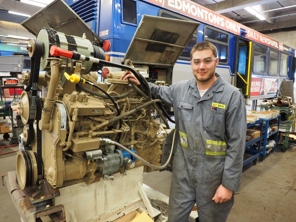 Apprentice heavy duty equipment technician Mackenzie Ryan is part of the team that repairs or replaces huge clean-diesel engines and transmissions around the 500,000 kilometer mark.