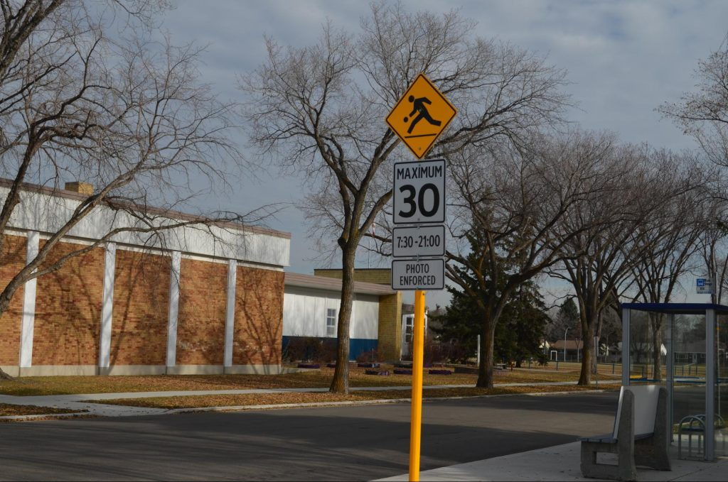 Maxium 30 Km/Hr playground traffic sign in front of a school
