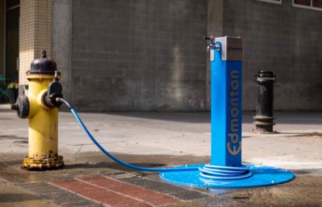 Fire hydrants tapped for fresh drinking water in Edmonton heat